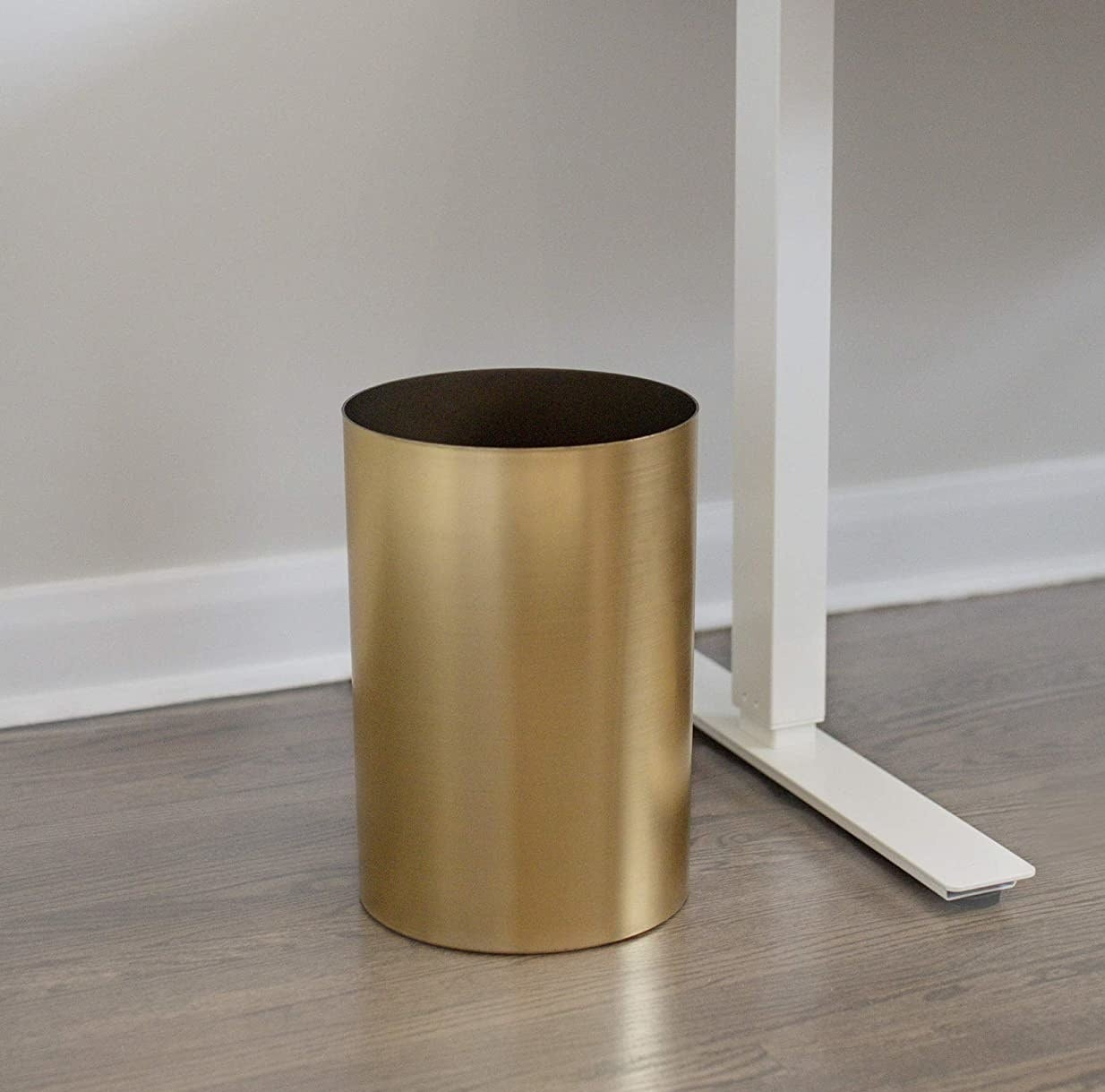 the trash can under a desk