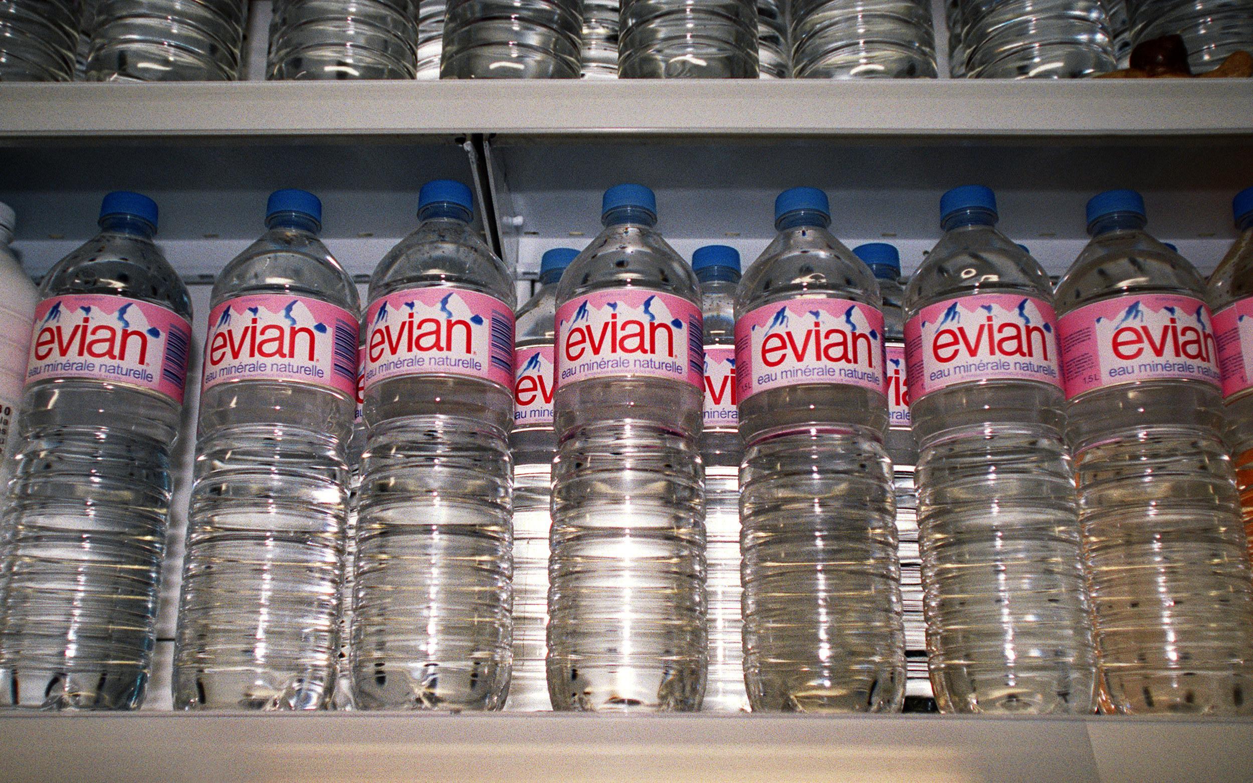 Evian bottles on a store shelf