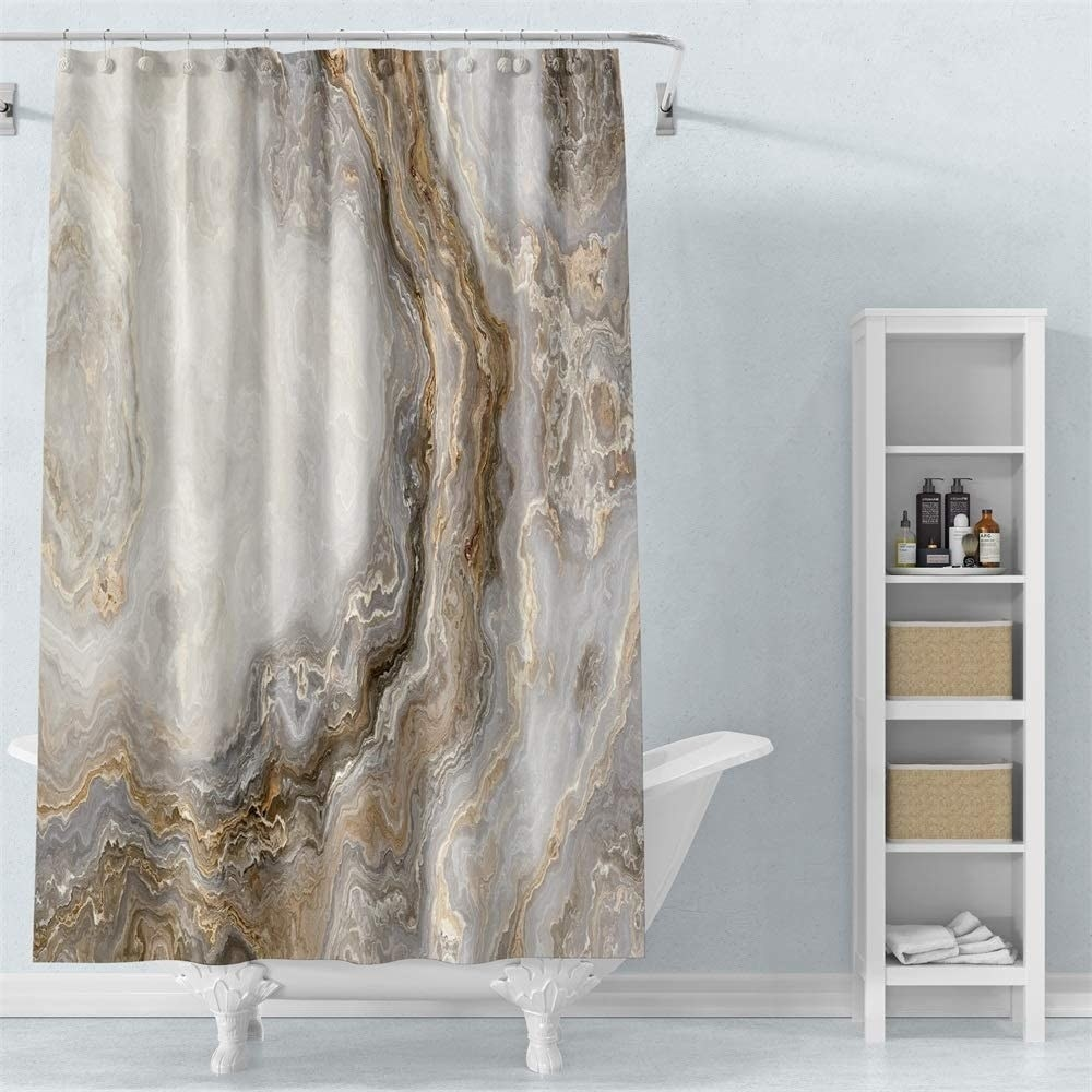 the shower curtain in front of a tub
