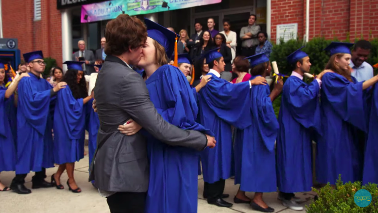 Eli and Clare kissing at her graduation