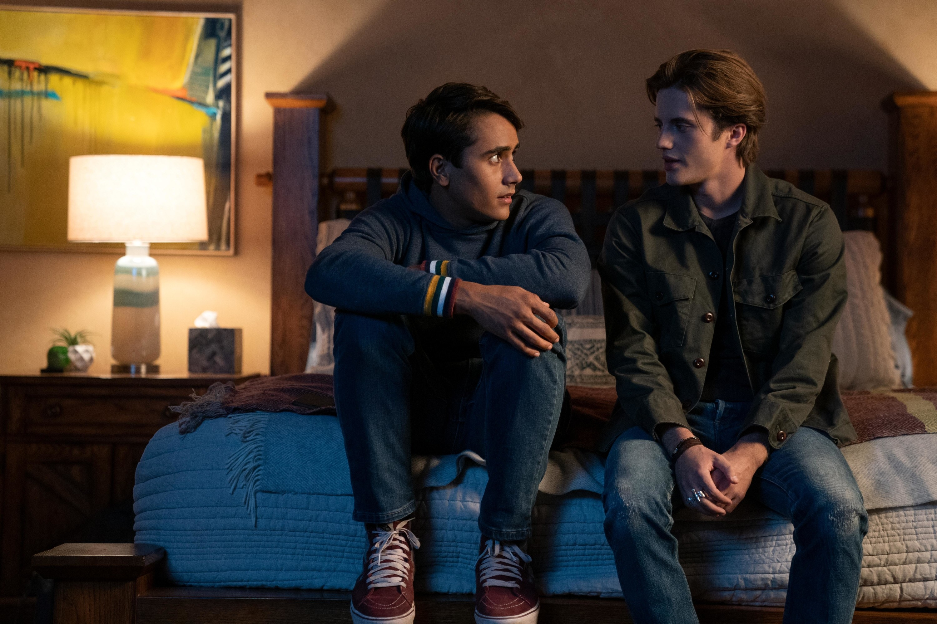 Michael and George sitting on a bed in a scene from Season 2