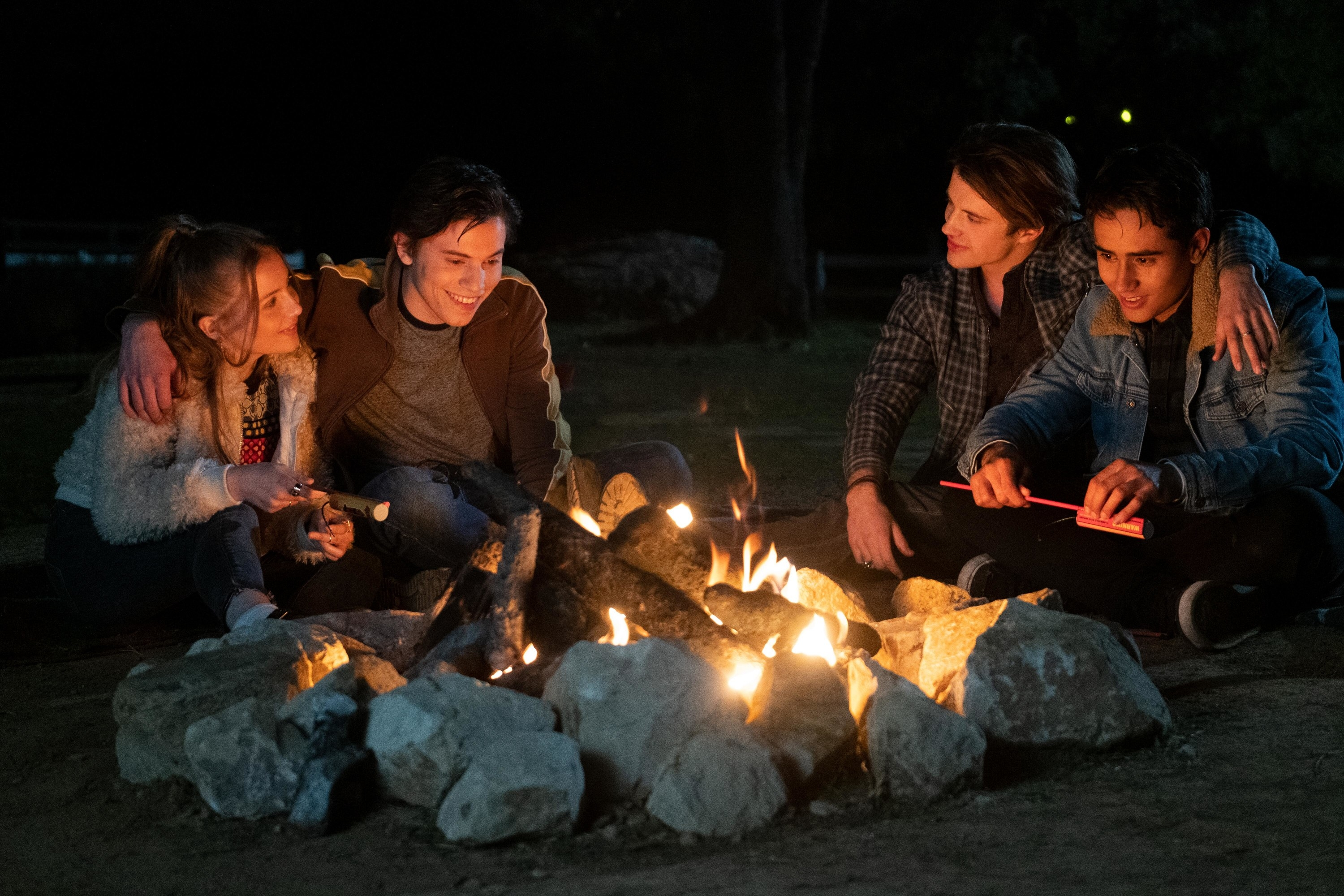 A scene with several members around a campfire