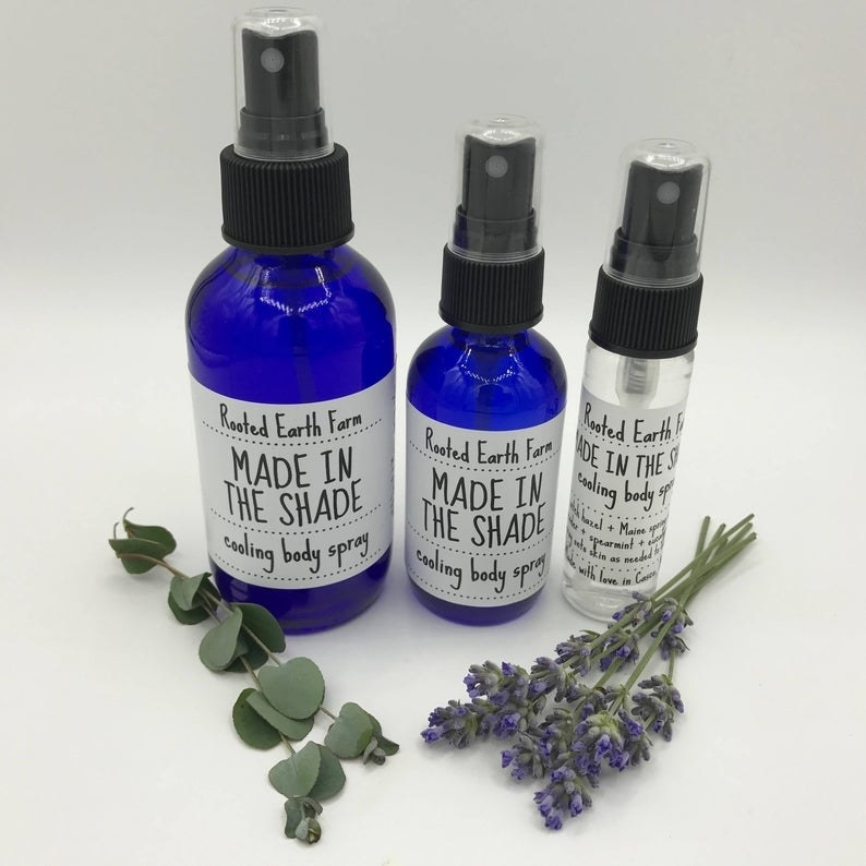 Three sizes of Rooted Earth Made In The Shade Cooling Body Spray in various sizes