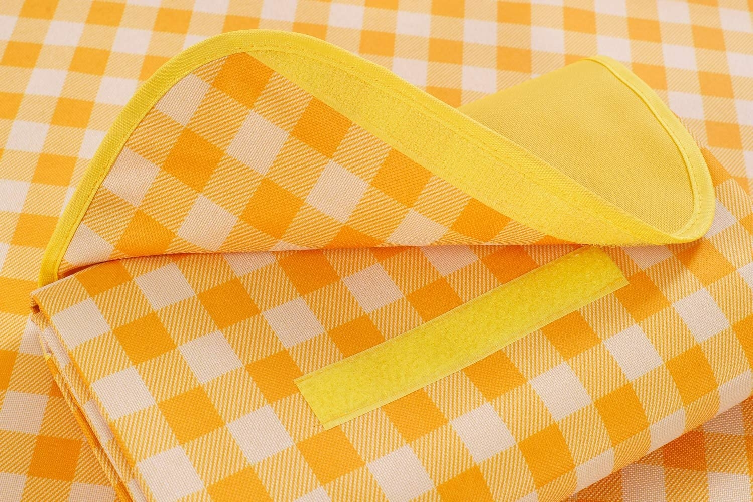A checkered picnic mat folded into a pouch