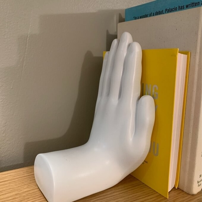 a reviewer's white hand bookend