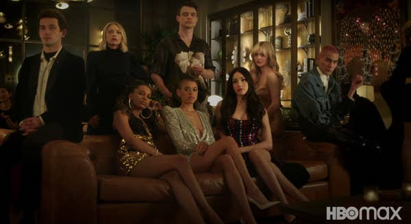 The cast of the Gossip Girl reboot sits on and around a couch