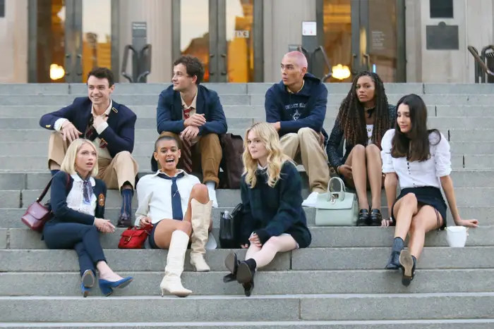 The cast of the Gossip Girl reboot sits on the Met steps