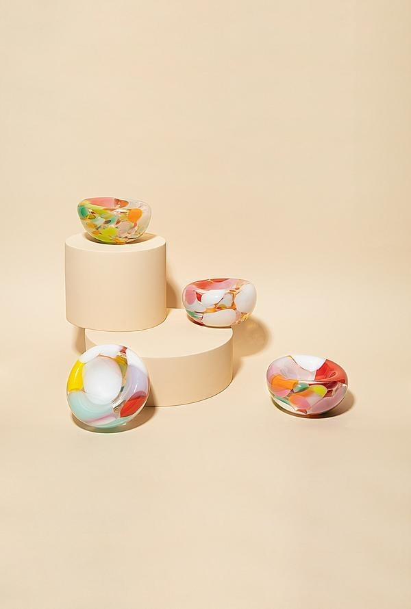 the ash trays that have an abstract pattern in colors of yellow white blue orange pink purple and red all over
