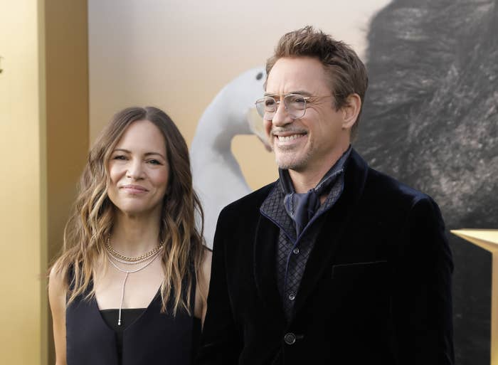 Susan Downey stands next to Robert Downey Jr; they're both smiling