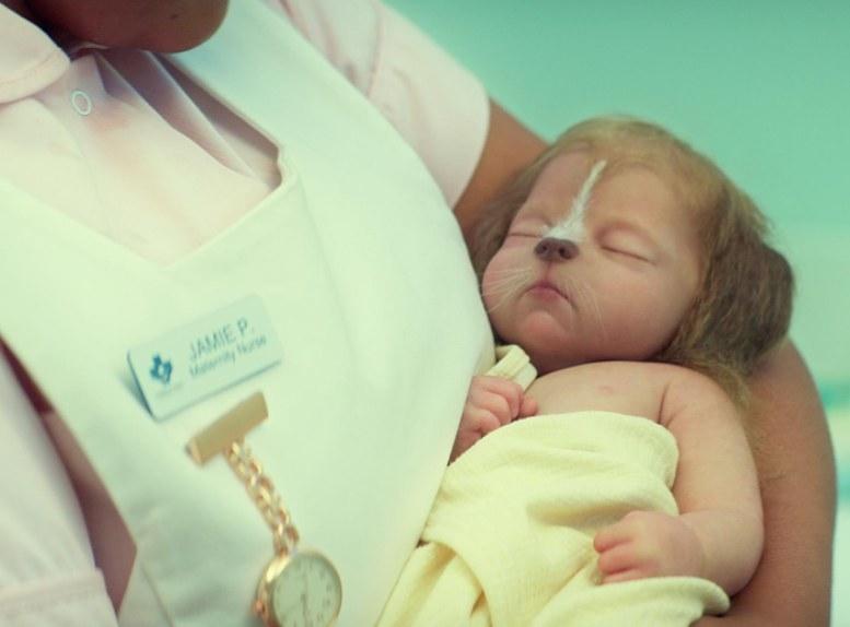 A nurse holds a dog hybrid baby