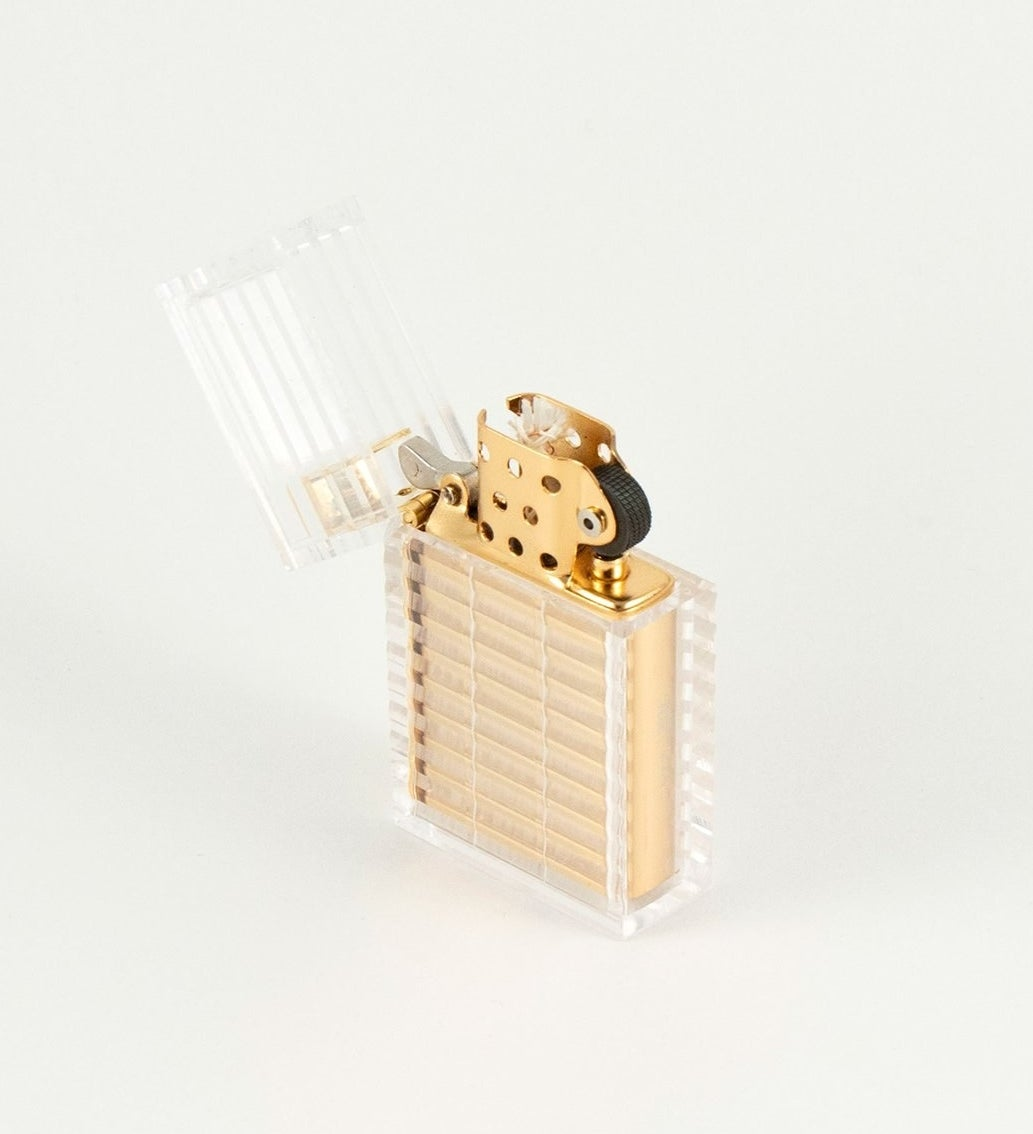 the transparent lighter that is clear on the outside and shows that the actual inside of the lighter is gold plated