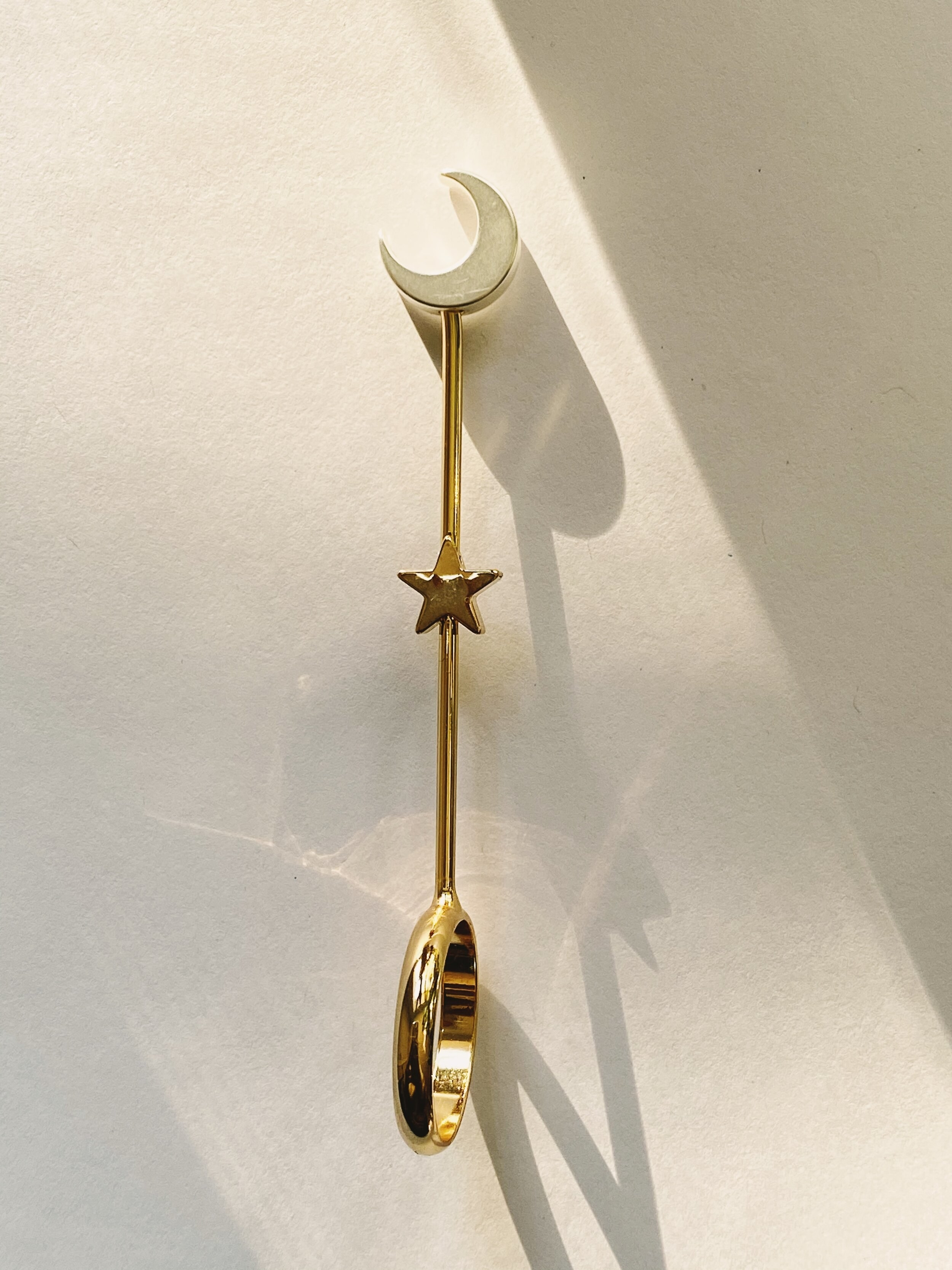the ring joint holder with a crescent moon as the place where you place the joint and the holder is gold plated with a star in the center