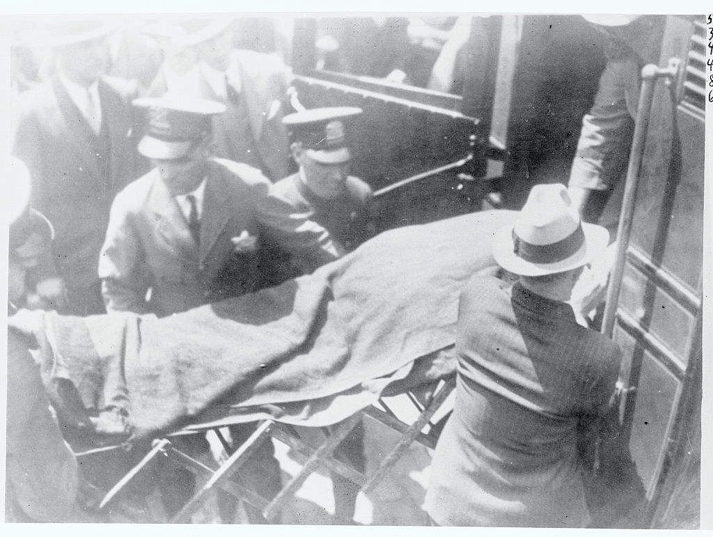 The body of Albert Jake Lingle being placed in an ambulance following his fatal shooting