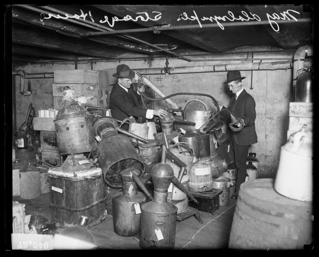 Major A.V. Dalrymple, associated with Prohibition, and an unidentified man sorting through a storage house in Chicago in 1920