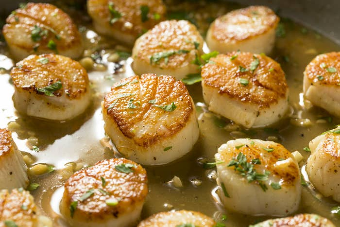 Cooking scallops in a skillet.