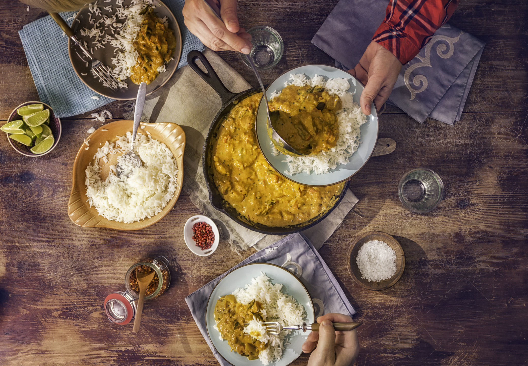 An Indian meal with rice and spiced chicken.