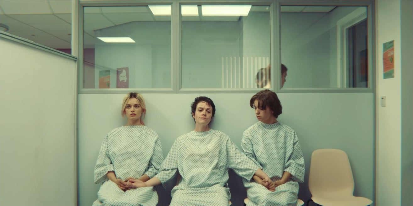 Maeve and two other women hold hands in an abortion clinic