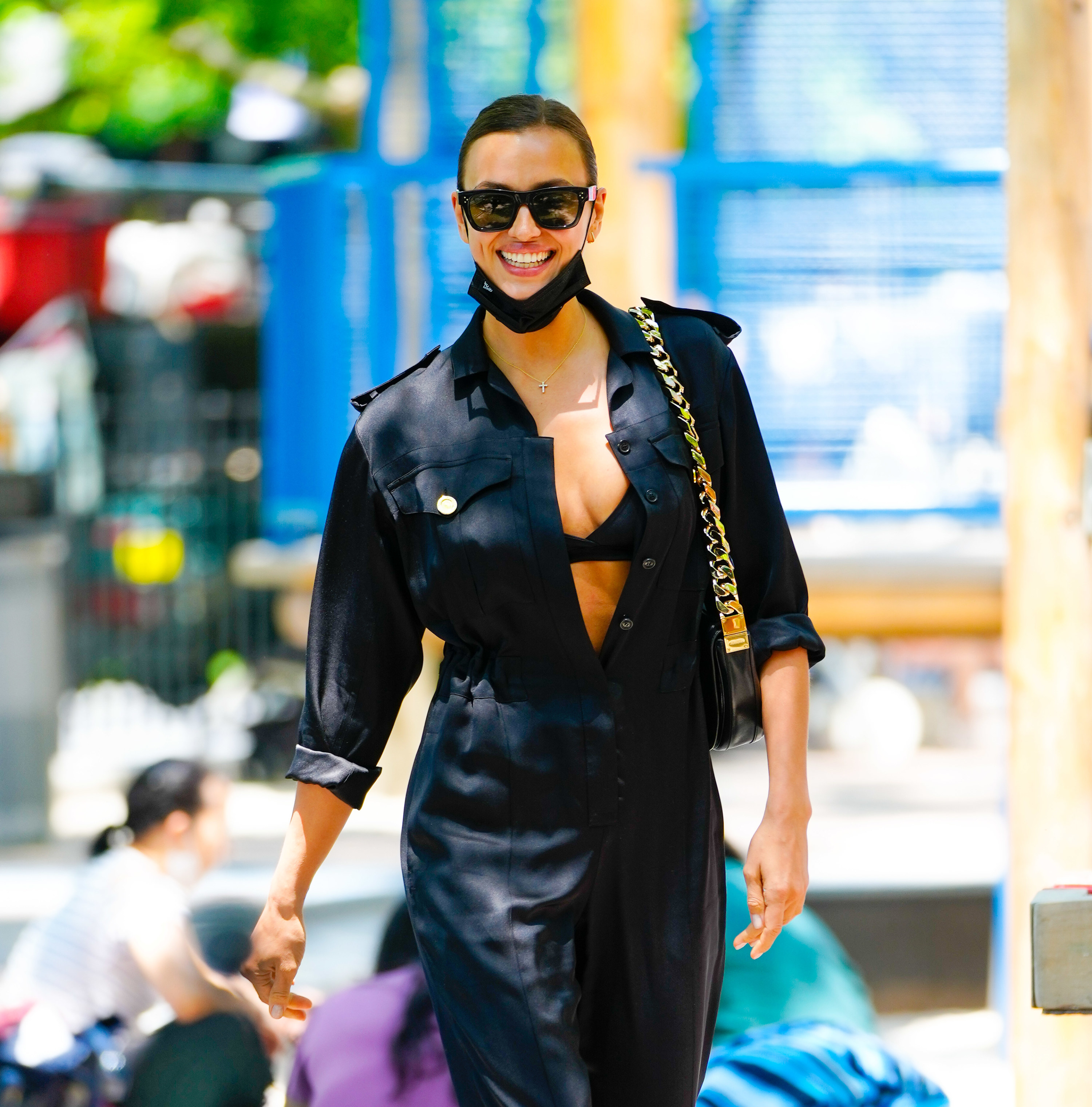 Irina Shayk is seen on June 10, 2021 in New York City wearing a jumpsuit and smiling