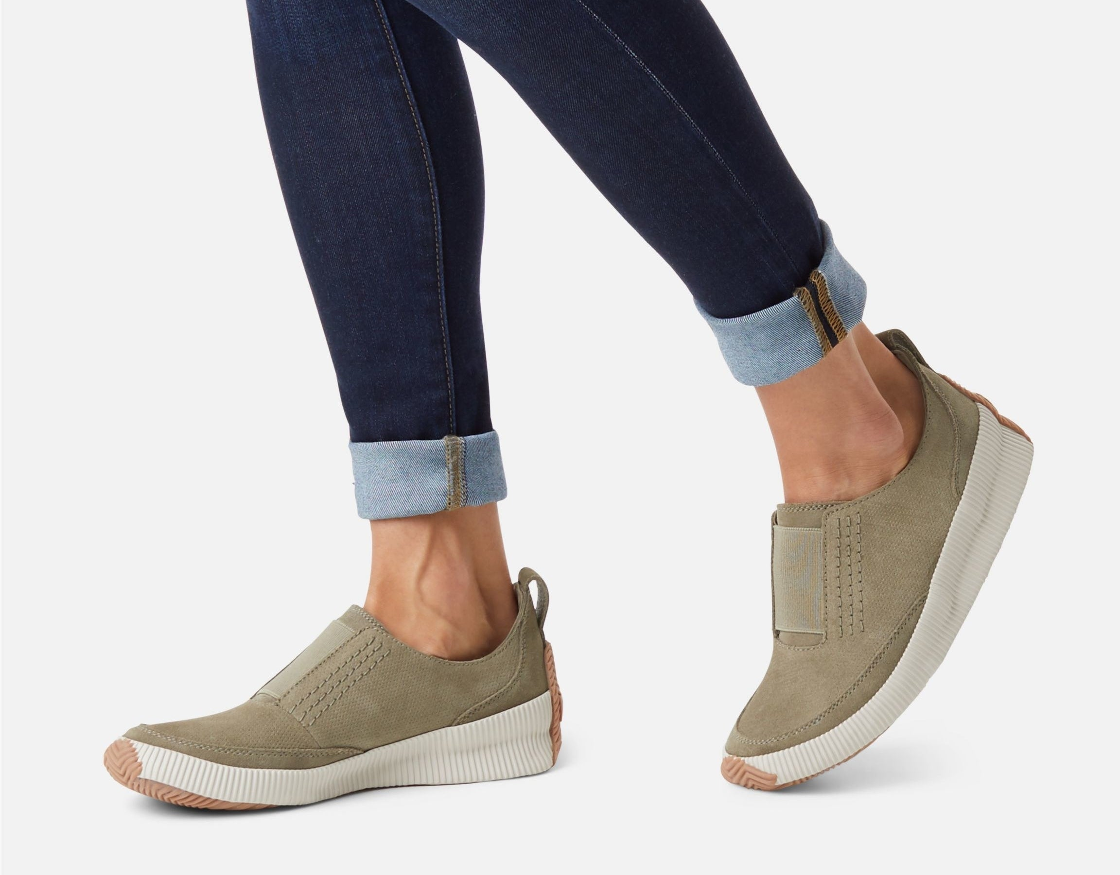 model wearing the slip-on shoes in the color sage