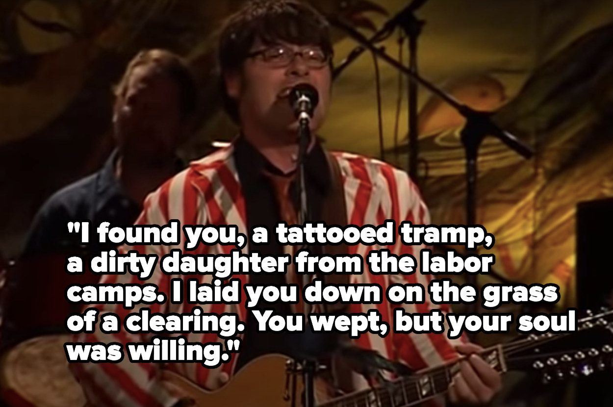 """Man singing into a microphone about how """"I found you,  a tattooed tramp, a dirty daughter from the labor camps"""""""