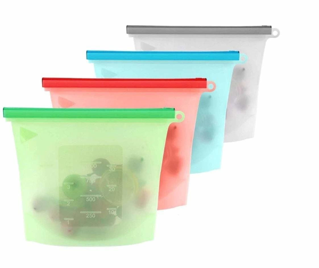 Storage bags in multiple colours with various food items in them.