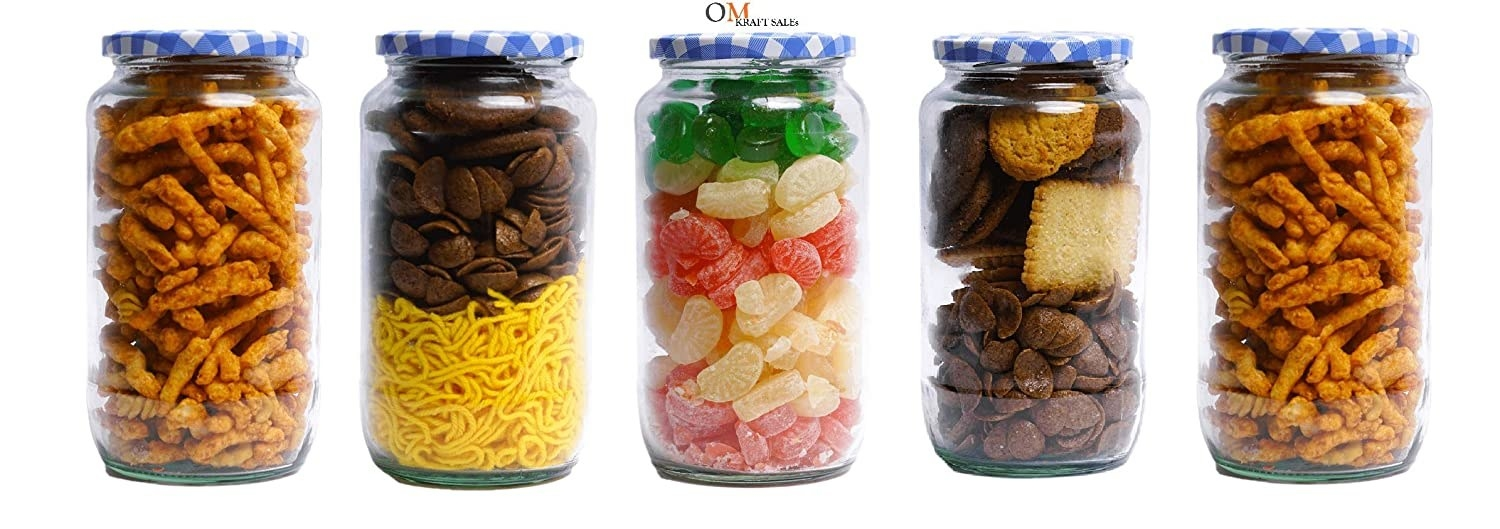 Multiple clear glass mason jars with various food items inside them.