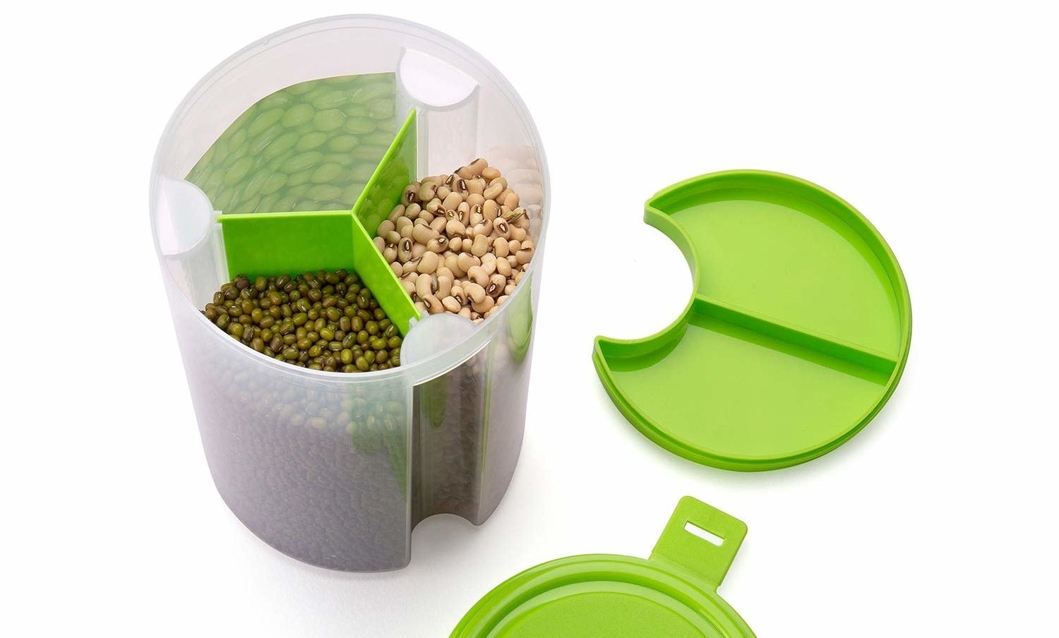An open container with different food items in its different compartments.