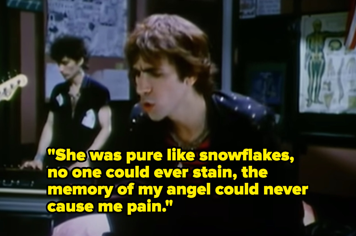 """Man singing """"She was pure like snowflakes, no one could ever stain, the memory of my angel could never cause me pain"""""""