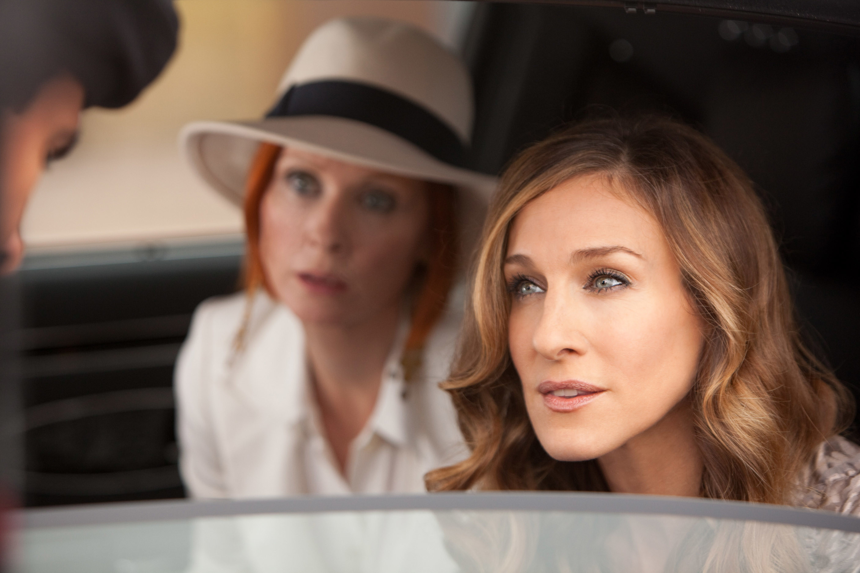 """Cynthia Nixon and Sarah Jessica Parker sit inside a car on set of the 2010 film, """"Sex And The City 2"""""""