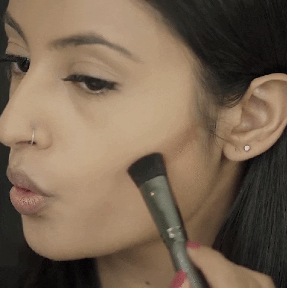 A person contouring their face