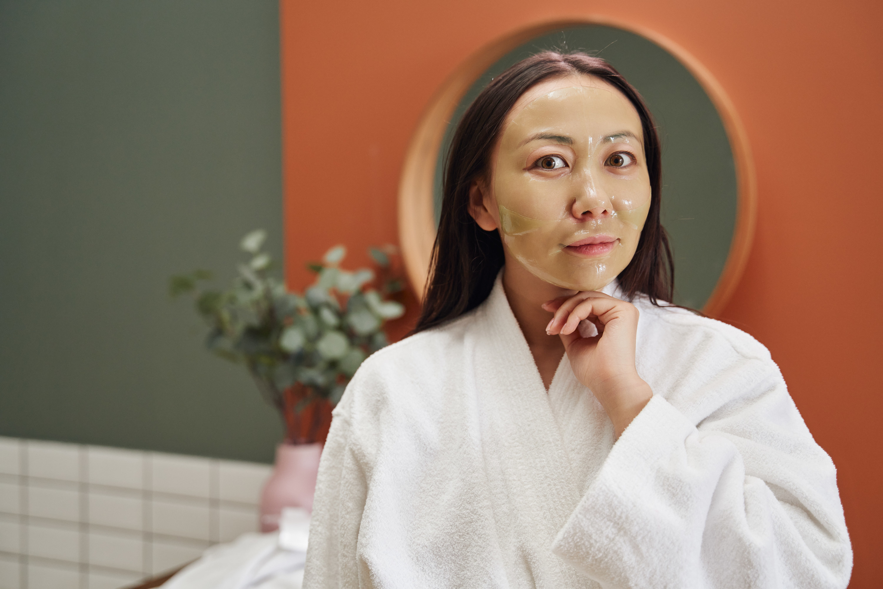 A person doing a skincare treatment
