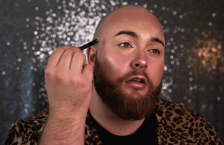 A person blending their makeup