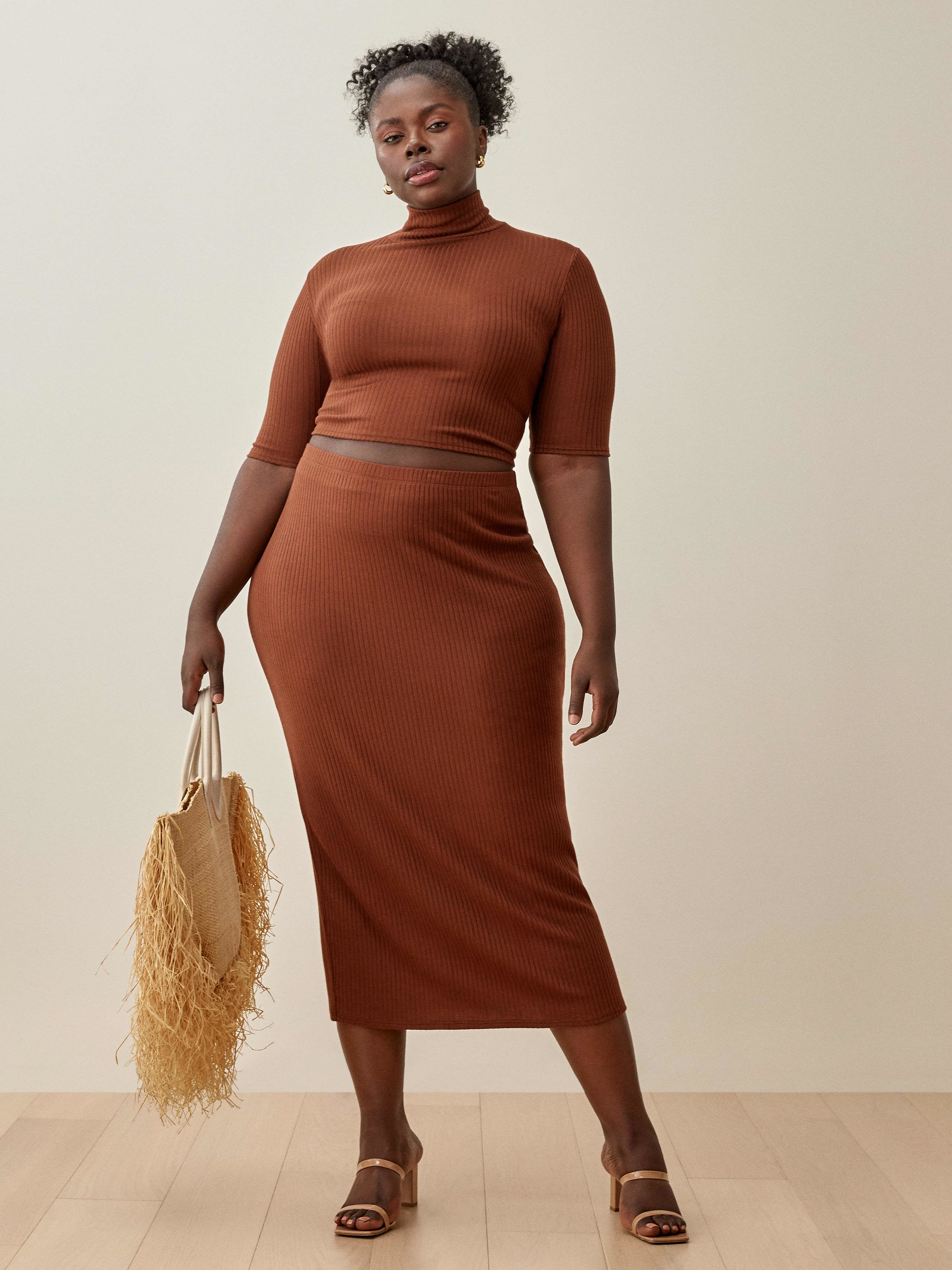 the chestnut colored midi pencil skirt and three quarter sleeved crop top