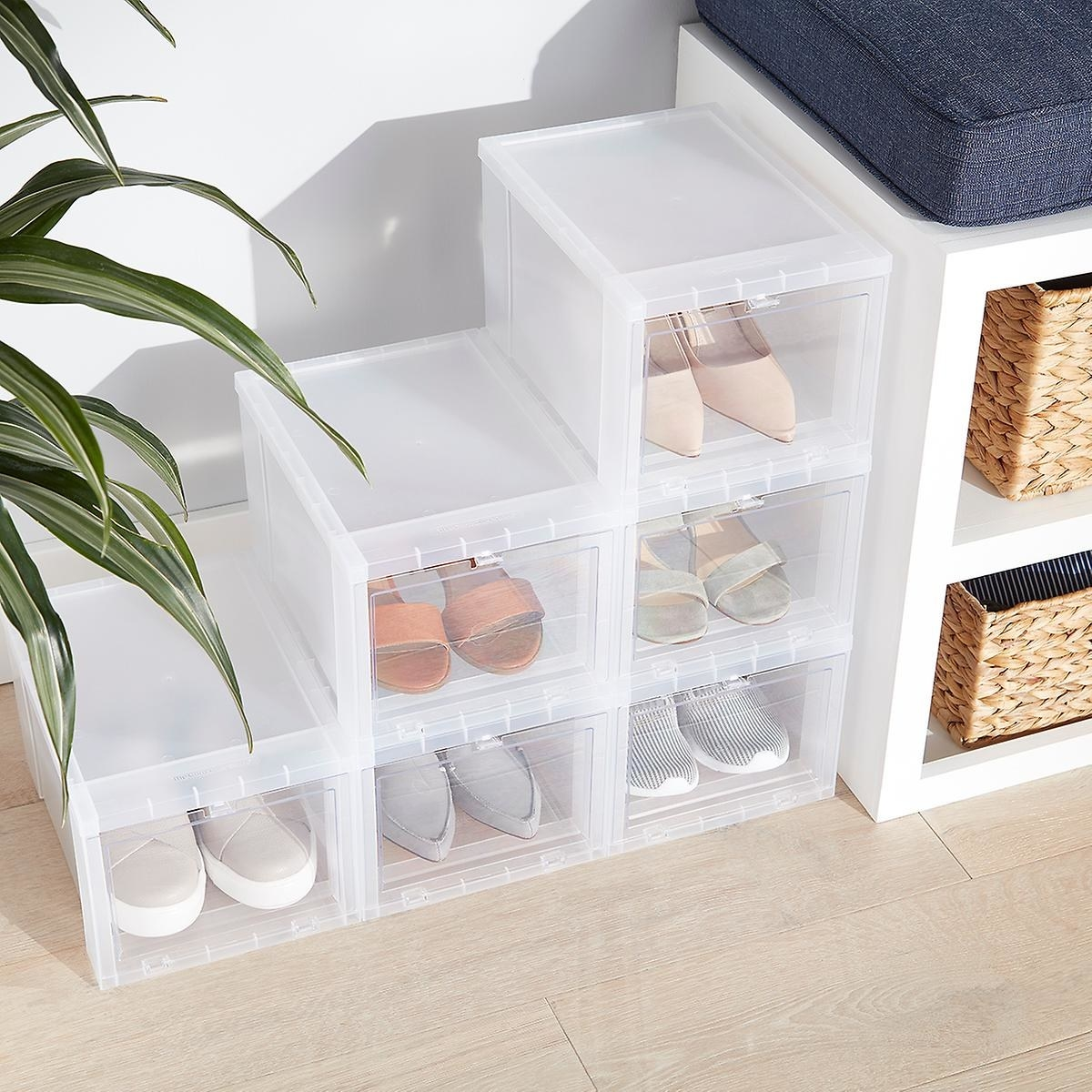 six of the clear shoe boxes with sandals, sneakers, and flats inside