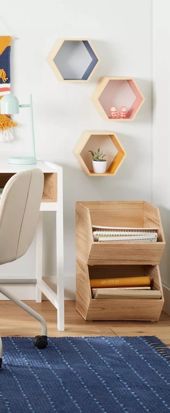 The hexagon-shaped shelves hanging on a wall