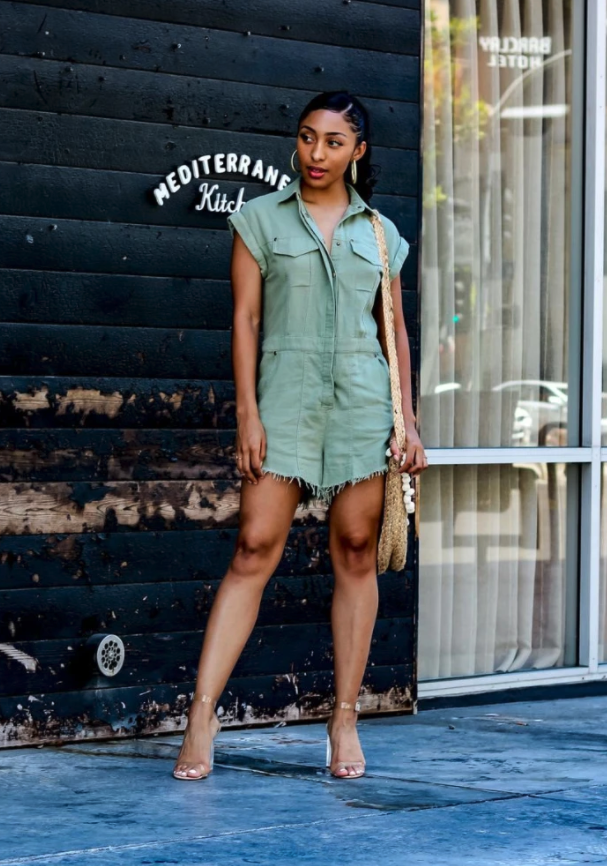 model wearing olive green linen romper with utility pockets