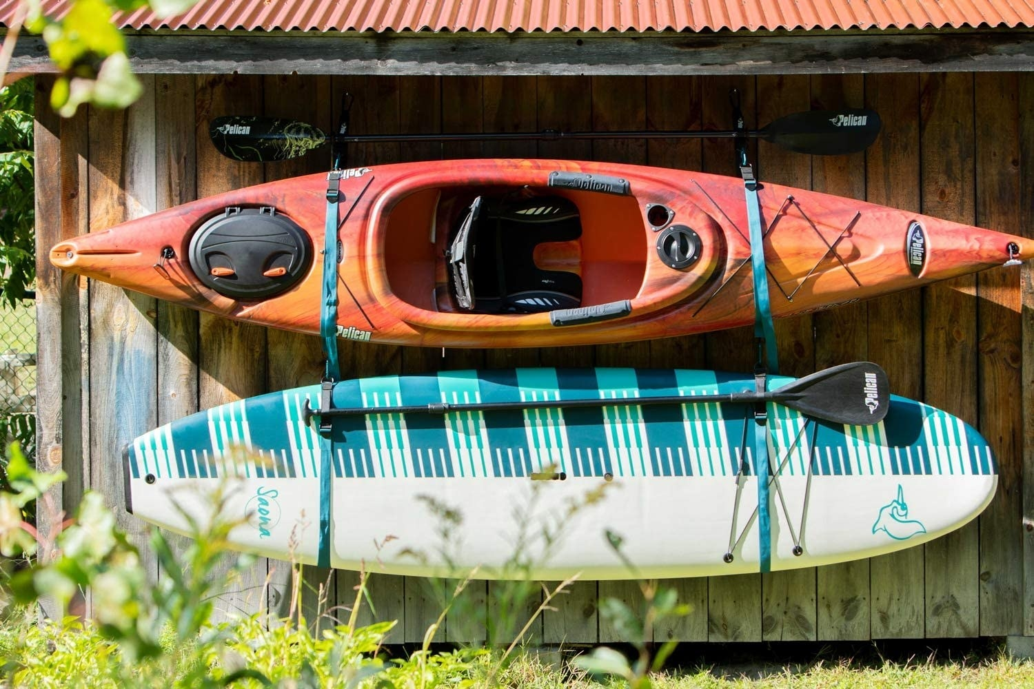A canoe and a paddle board in the straps