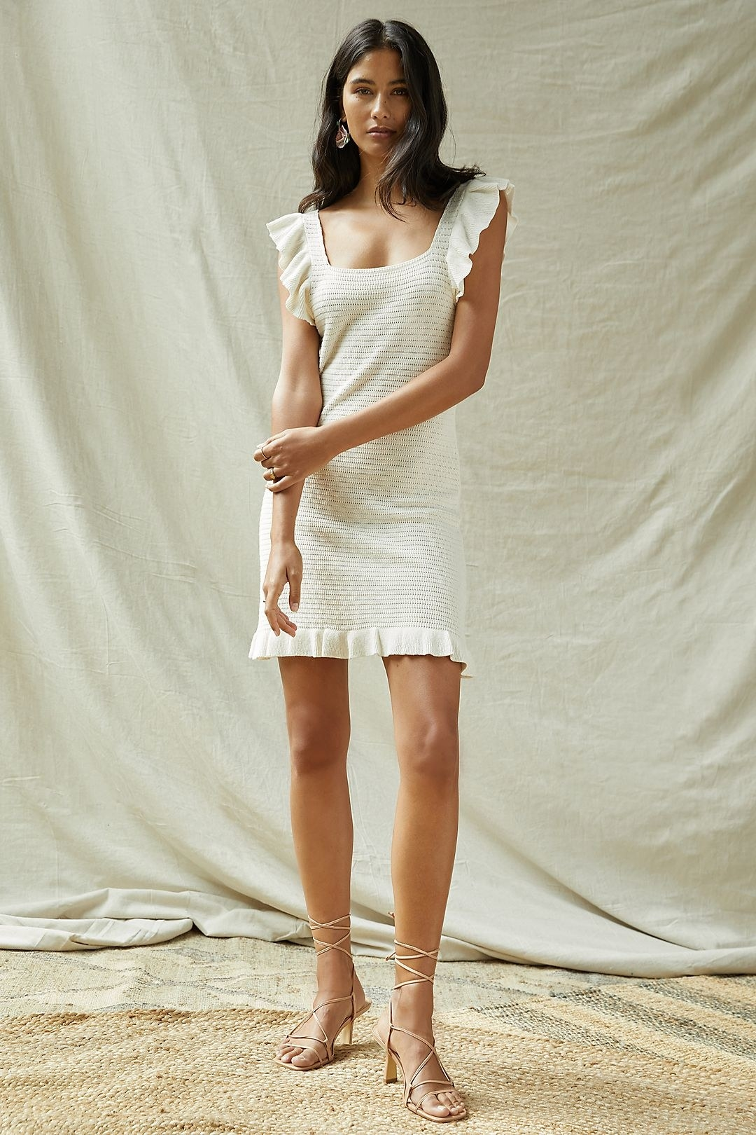 model wearing the cream dress