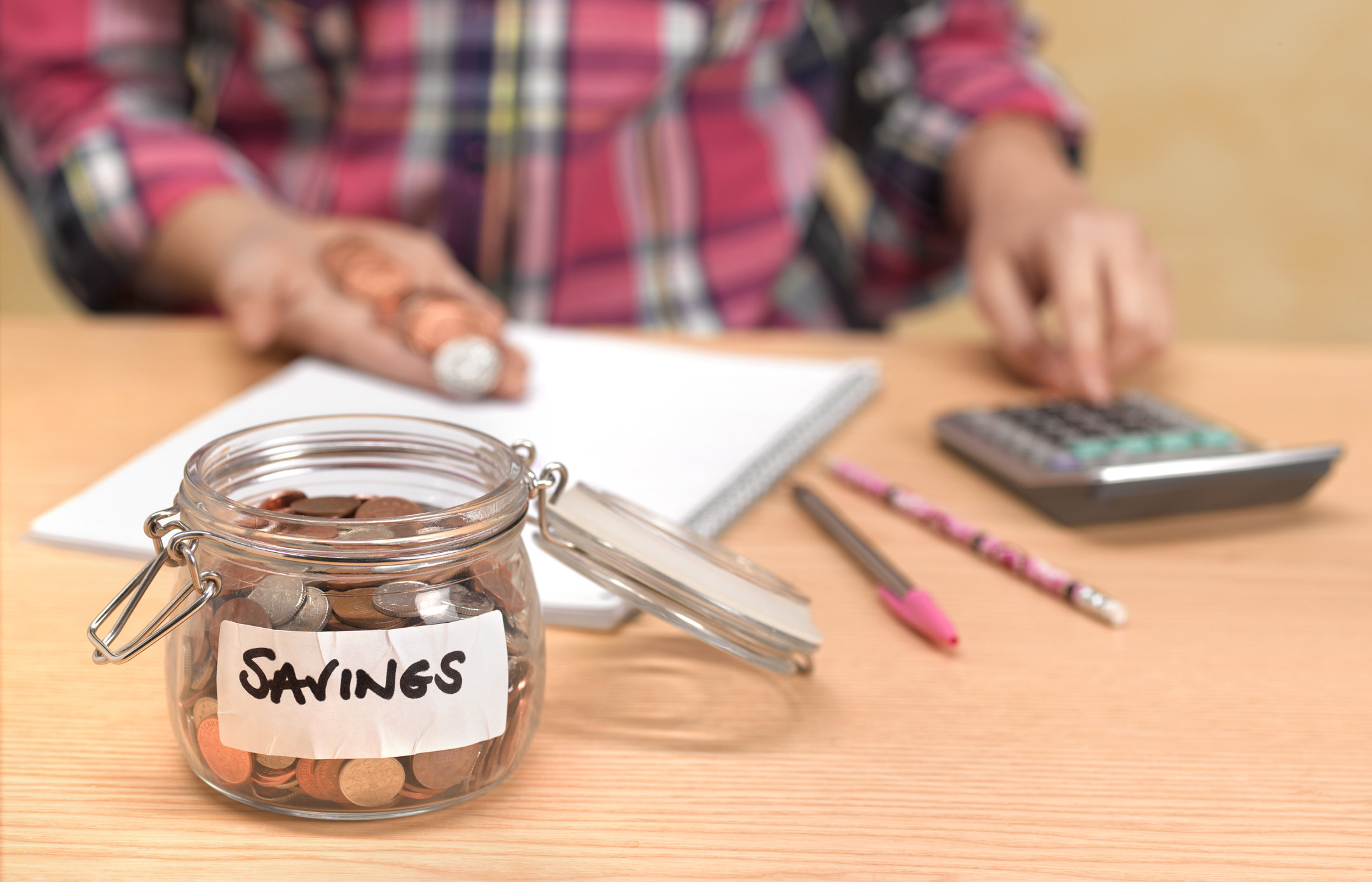 Jar with coins for savings