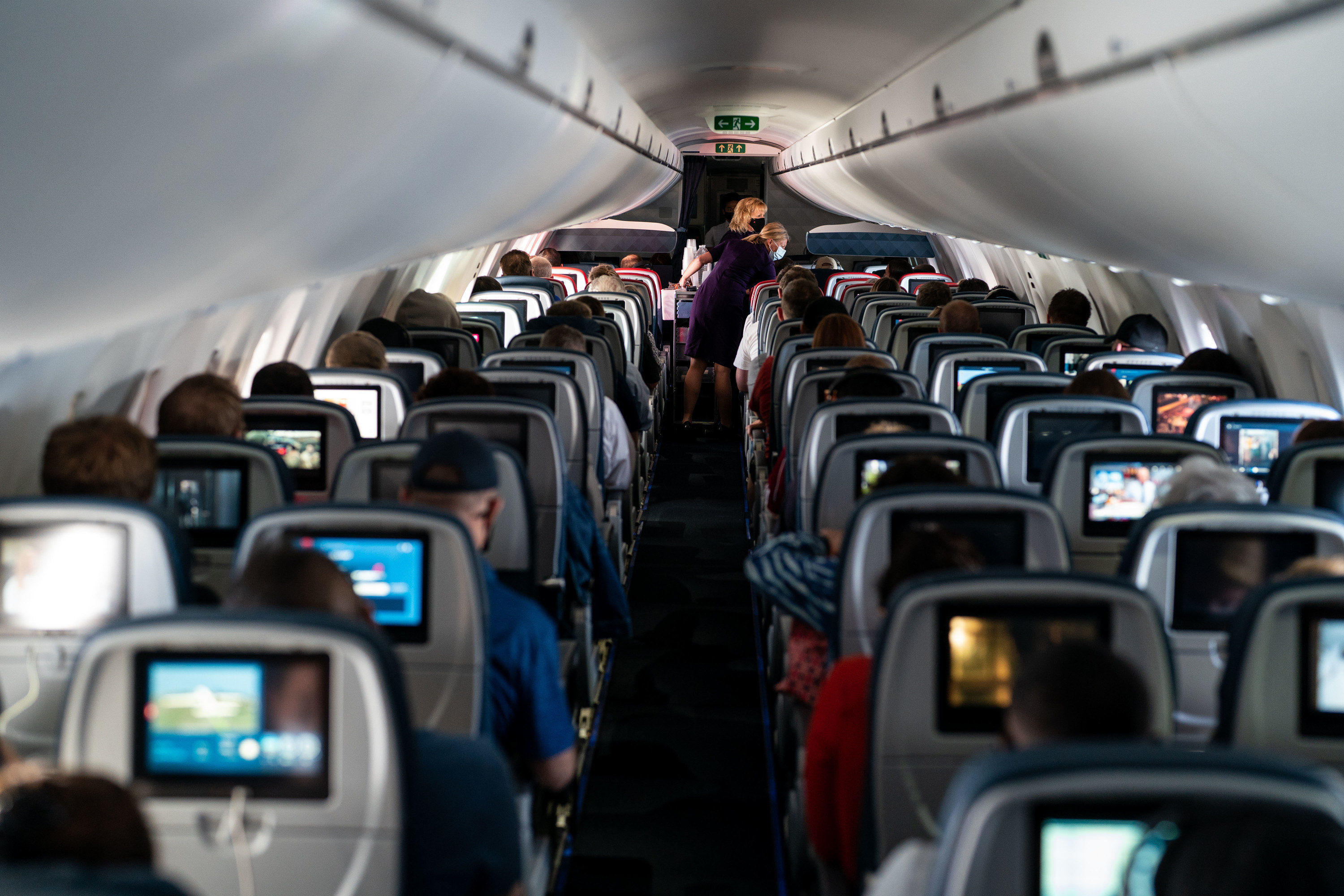 A plane with passengers and flight attendants