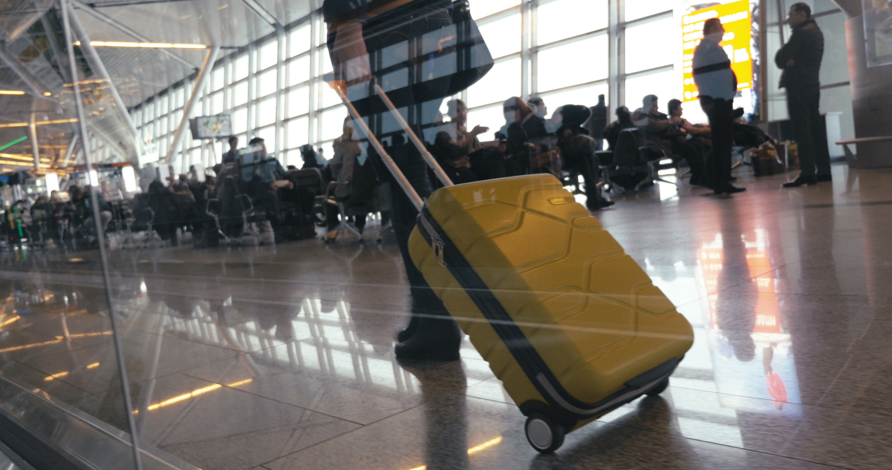 A person walking with luggage