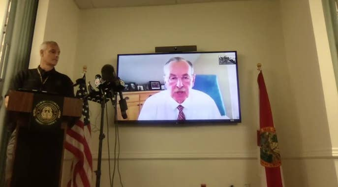 Sheriff Ric Bradshaw is shown speaking on a TV screen
