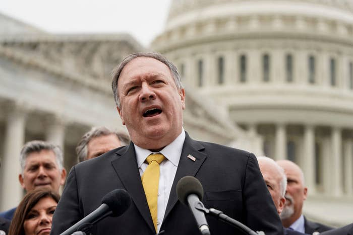 Then–secretary of state Mike Pompeo speaks at a podium.