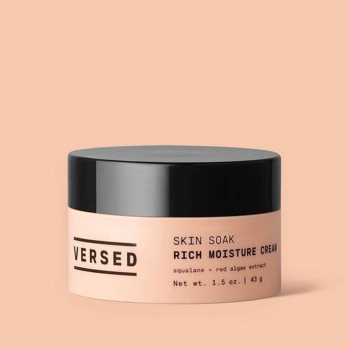 jar of versed skin soak against peach background
