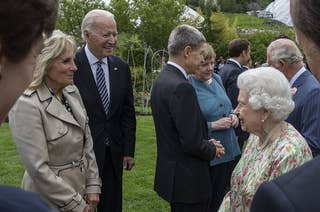The queen is shown chatting with the Bidens
