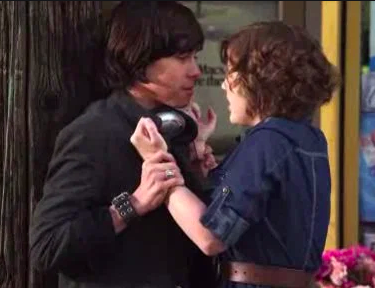 Eli and Clare holding each other by bench in Season 10