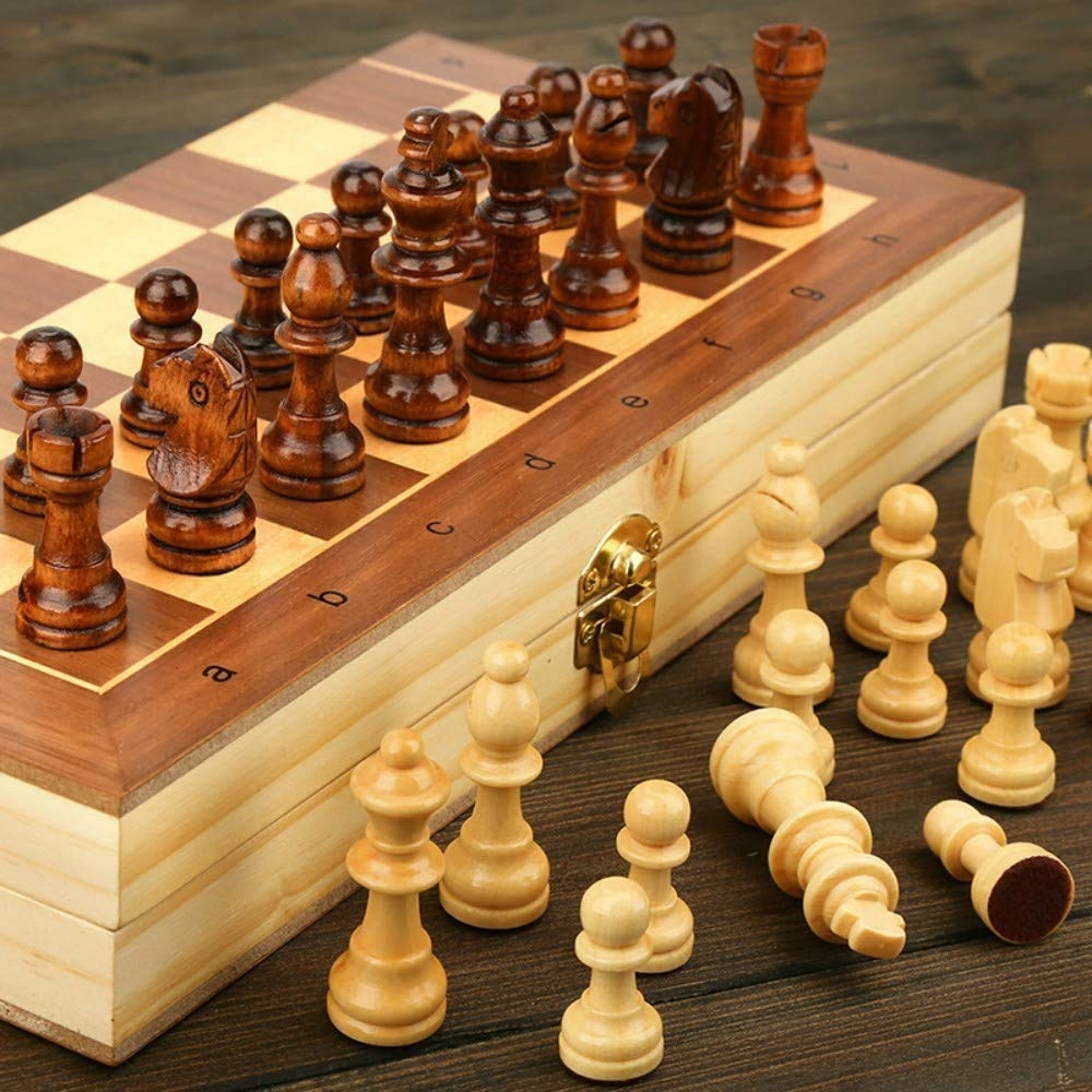 A chess set with different pieces around it