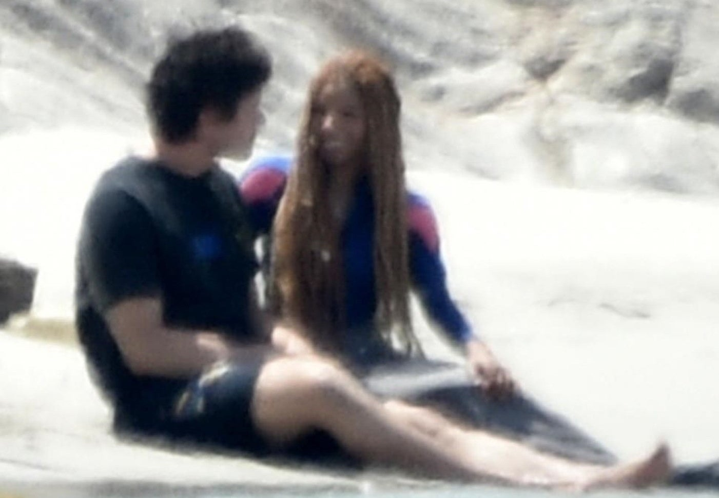Close-up of them by the water; Halle is smiling