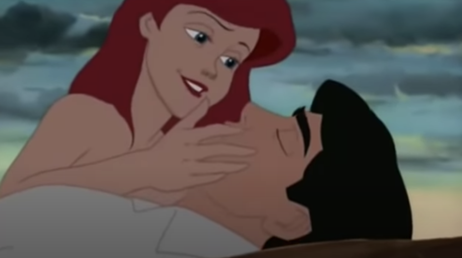 Animated shot of Ariel cupping the face of a prone Eric in her hands