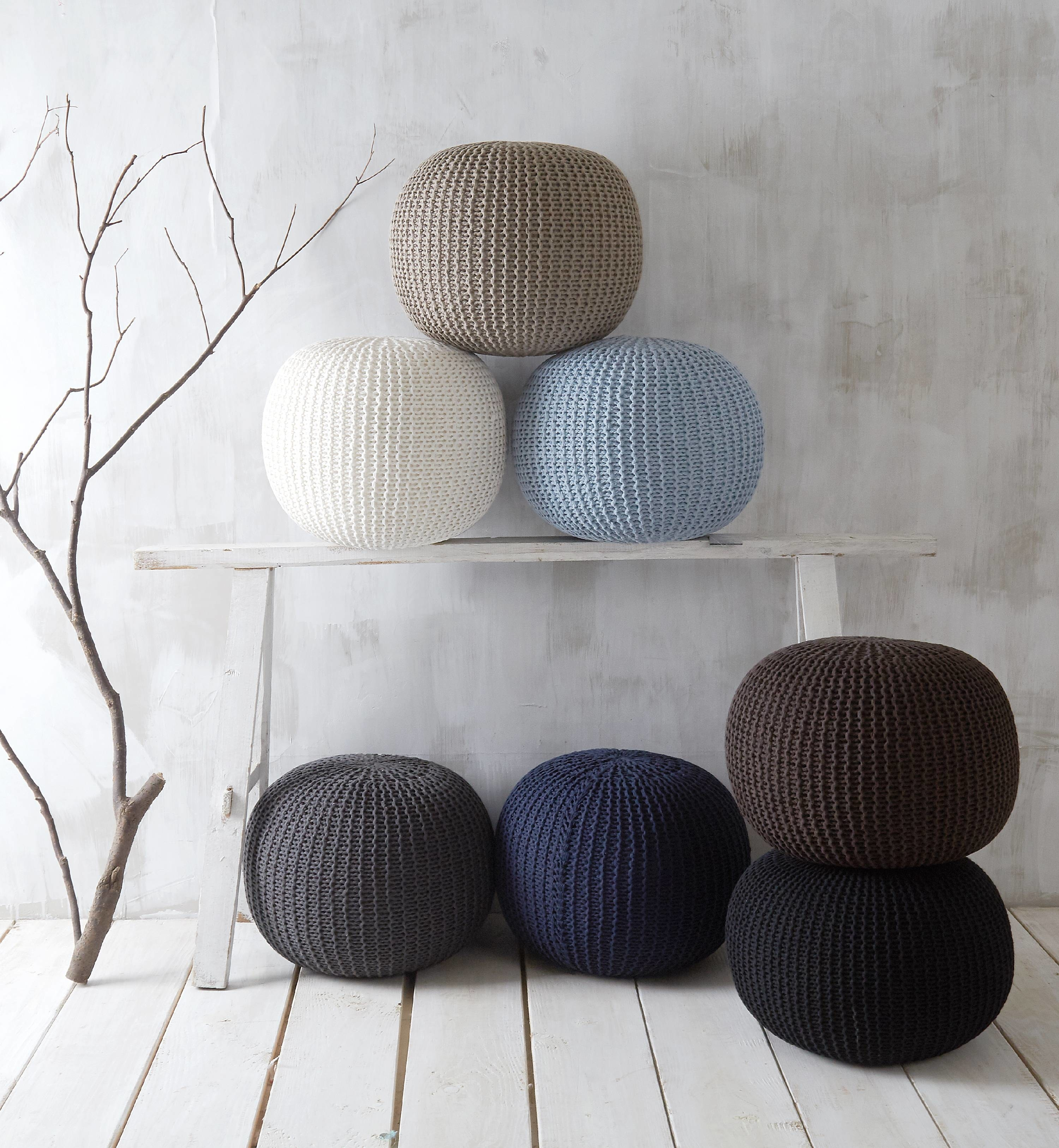 woven round pouf in hues of blue, brown, black, and white
